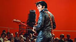 Elvis in his 1968 NBC comeback special, wearing a black leather jumpsuit