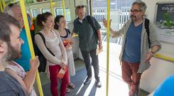 The Rail thing: Frank Coughlan (second from right) takes part in 'Plays on a Train' as writer Gavin Kostick (far right) talks to the group on the Dart. Photo: Doug O'Connor
