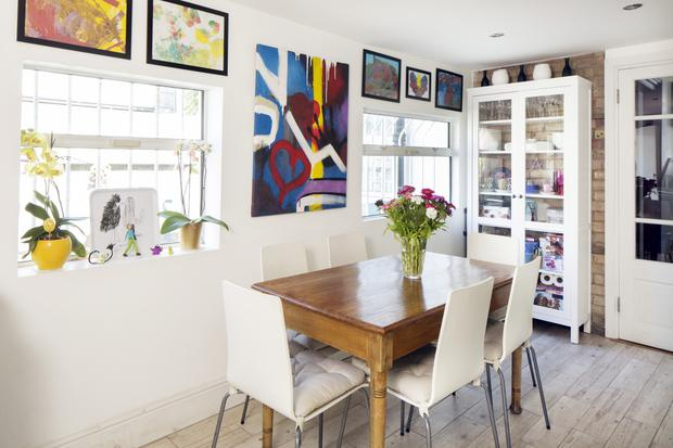 The kitchen in Mariam Ribon's home in Dublin 8. Many of the framed drawings are by her sons, Ethan and Joshua.