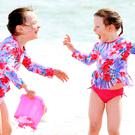 Fun in the sun: Savannah (6) and Maddison Bradley (5) play on the beach. Sunshine helps boost people's mood with the production of serotonin. Photo: Gerry Mooney