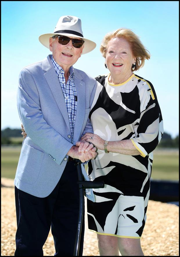 Gay Byrne and wife Kathleen Watkins enjoying the Dubai Duty Free Irish Derby at the Curragh. Photo: Steve Humphreys