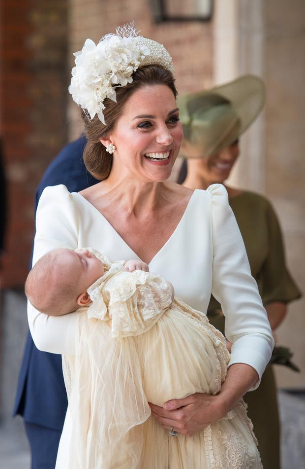 Proud mum: Kate Middleton with Prince Louis at his christening on Monday. Photo: Reuters