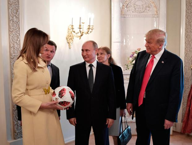 Trump with his wife Melania and Russian president Vladimir Putin