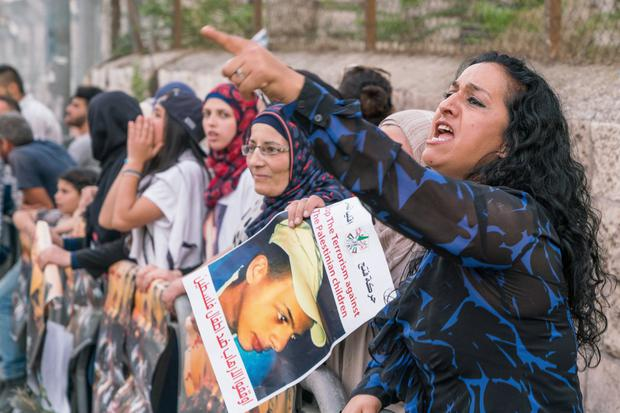Protests at the trial of an Israeli man charged with burning a 15-year -old Palestinian boy to death in a local park. He got a life sentence.