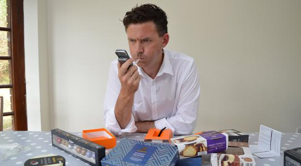 Take it to the limit: Bill Linnane blows into his breathalyser after gorging on alcoholic desserts