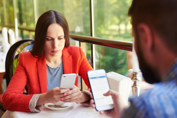 Cutting the small talk: Online communication is taking over from actual conversation. Stock Image