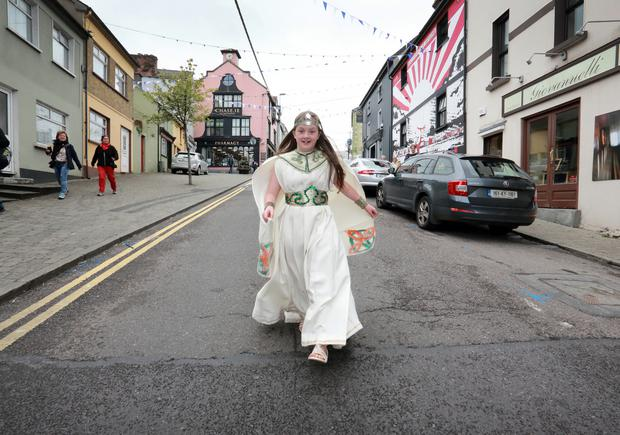 Ceremonial robes: Queen of the Puck Fair Ella Foley (12) skips down Lower Bridge Street in Killorglin, Co Kerry. Photo: Frank McGrath