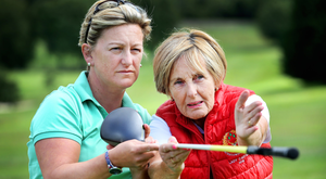 Chipping in: Carol Brill with golfing guide Joan Moore who is Lady Captain at Stackstown Golf Club. Photo: Steve Humphreys