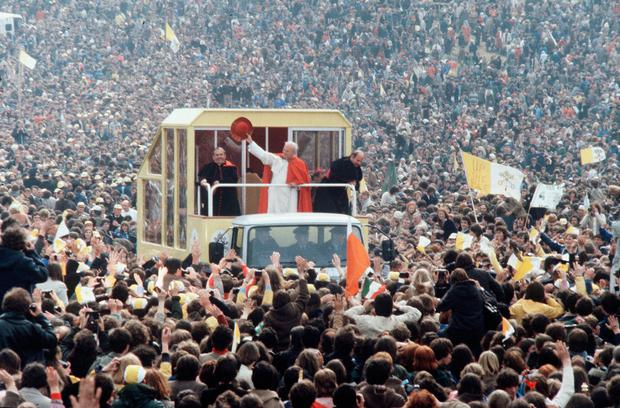 En masse for Mass: Pope John Paul II waves to the crowds during his visit in 1979