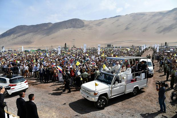 Hot water: Pope Francis arrives on the popemobile at the site at Lobitos Beach, to celebrate an open-air mass caused outrage on the trip when he suggested that some of the country's victims of clerical sex abuse were lying.