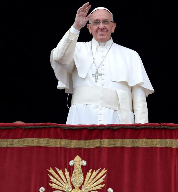 Christmas blessin: Pope Francis waves as he delivers a
