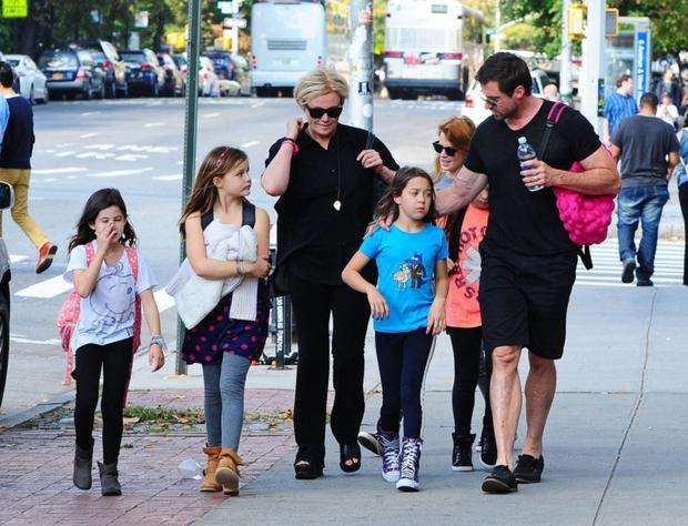 Hands on: Hugh Jackman does the school run