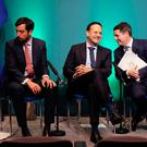 Man in the middle: Eoghan Murphy, Leo Varadkar and Paschal Donohoe at the launch of the Project Ireland 2040 funds in Government Buildings last May. Photo: Brian Lawless/PA