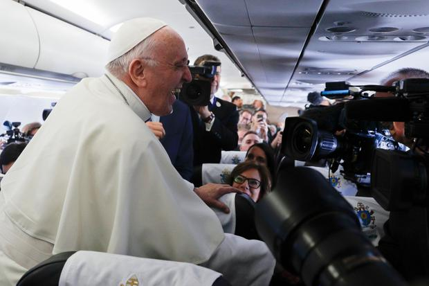 Morning, Pápa: Pope Francis talks to journalists aboard the flight from Fiumicino airport in Rome to Dublin last Saturday. Photo: Gregorio Borgia/AFP