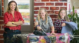 Deborah Donnelly and her daughters Frankie (11) and Casey (10) do the ironing. Photo: Tony Gavin