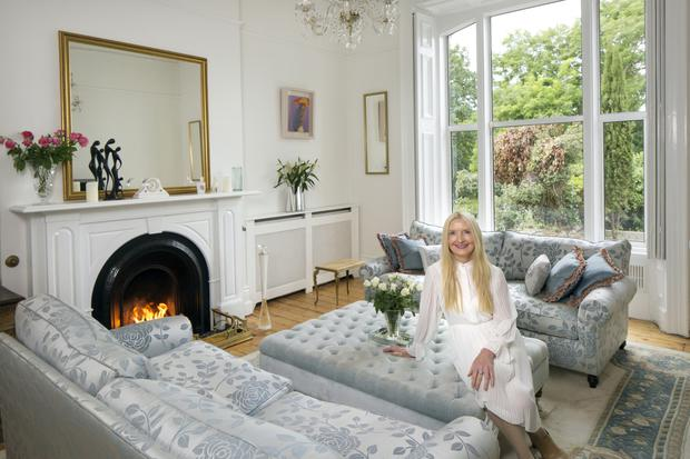Actress and best-selling author Claudia Carroll in her living room. Her good friend, Sharon Devlin, helped her with the silver-grey and cream colour scheme. Photo: Tony Gavin