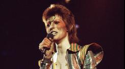 David Bowie performing on stage in 1973