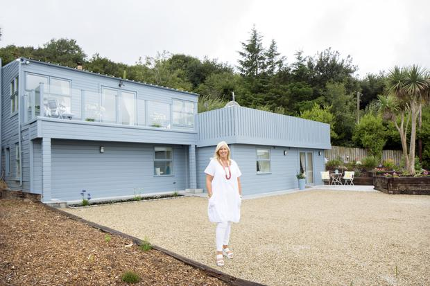 Lorraine Murray outside her stunning beach house in Wexford. An upside-down house, the four bedrooms are at garden level, while the living areas and decks are on top