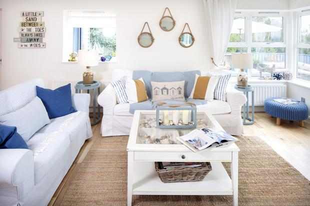 Blue is a typical colour to opt for when decorating a house by the sea. Lorraine Murray mixes different shades to great effect. The three mirrors were €6.95 each in Aldi