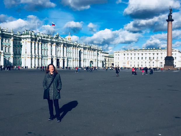 Anna at Palace Square in front of the Winter Palace, the Hermitage and the Alexander Column