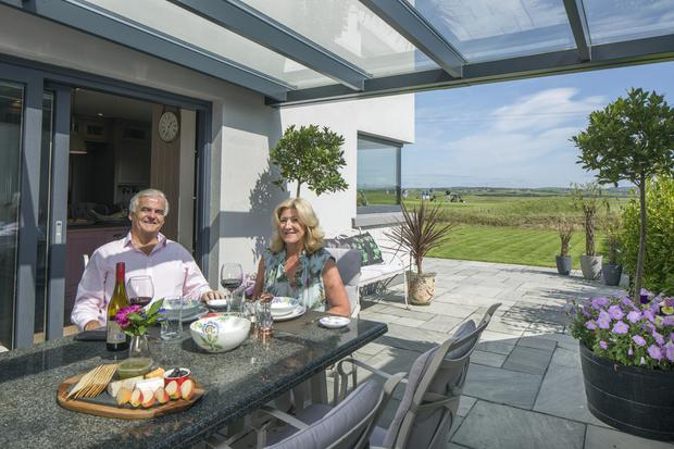 Mark and Maria in one of their favourite spots, the covered outdoor dining area, which gives views over the Lahinch Castle course, near their holiday home