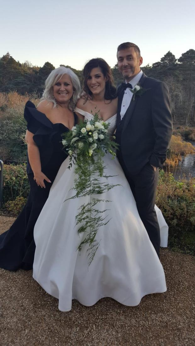 Debbie with her daughter Sophie and her new son-in-law Tom on the couple's wedding day in Ballynahinch Castle