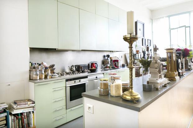 A large part of the big open-plan space in Neil Gurry and Karen Brennan's apartment is devoted to the kitchen. Both love to cook, and manage to work around the profusion of clocks and other artefacts