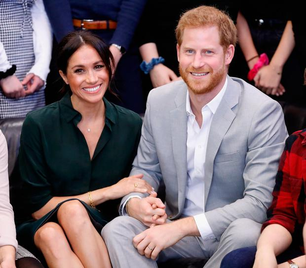 Prince Harry and Meghan get their PDAs just right. Photo: Getty Images
