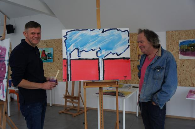 Brendan pictured with his finished painting, and artist Mick Mulcahy, who delivered the Artform course in Dunmore East