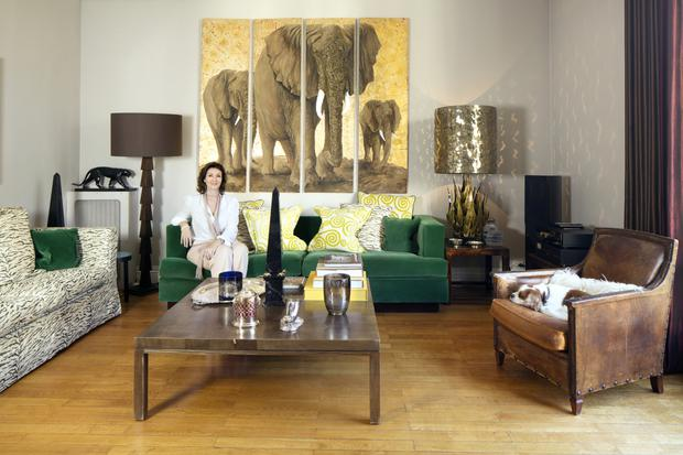 Helen Lambert Kennedy in her living room. Helen bought the four panels depicting elephants at the Marche Aux Puces flea market; the gold lamp, which she bought from an LA gallery, is by Paul Evans. Photo: Tony Gavin