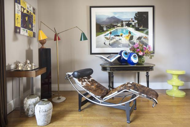 Every corner of Helen Lambert Kennedy's home is furnished with carefully chosen pieces. In this part of the main living room, she juxtaposes a photograph by celebrated American photographer Slim Aarons with a Le Corbusier recliner. The 'eye' vases are from a Turkish design company, Gaia&Gino, while the other wall hanging is a framed scarf by Rene Blanchard