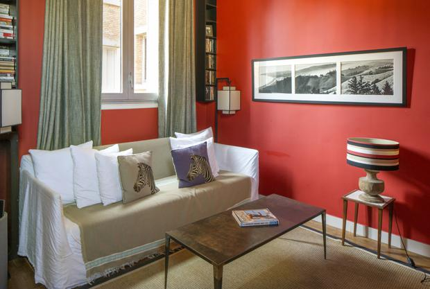 Helen loves colour, and this tomato shade works really well in the more informal living room. The black and white photos on the wall depict California where Helen always holidays with her family