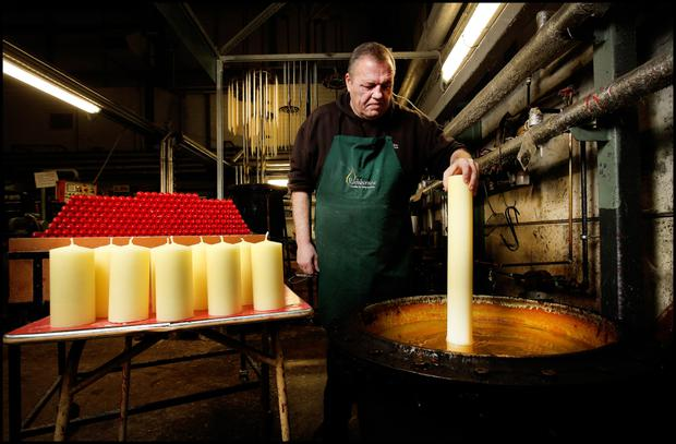 Master Chandelier John Smith dipping candles at the Rathbornes 1488 plant at Rosemount Business Park, Blanchardstown. Pic Steve Humphreys