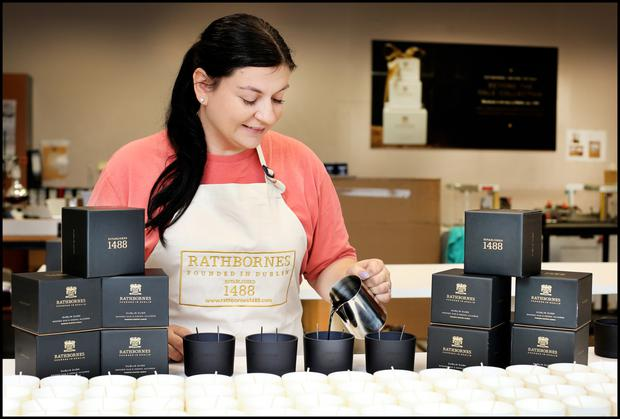 Burning passion: Jurgita Gausyte, scented candle production manager, pouring the latest range 'Dublin Dusk'