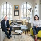 Hotel consultants Tim Whyte and Breda McEnaney in their light-filled living room, with its two sets of French doors opening onto the balcony. The set of ceramics hung vertically behind Breda's head are by Sinead Glynn, an Irish ceramic artist. Photo: Tony Gavin