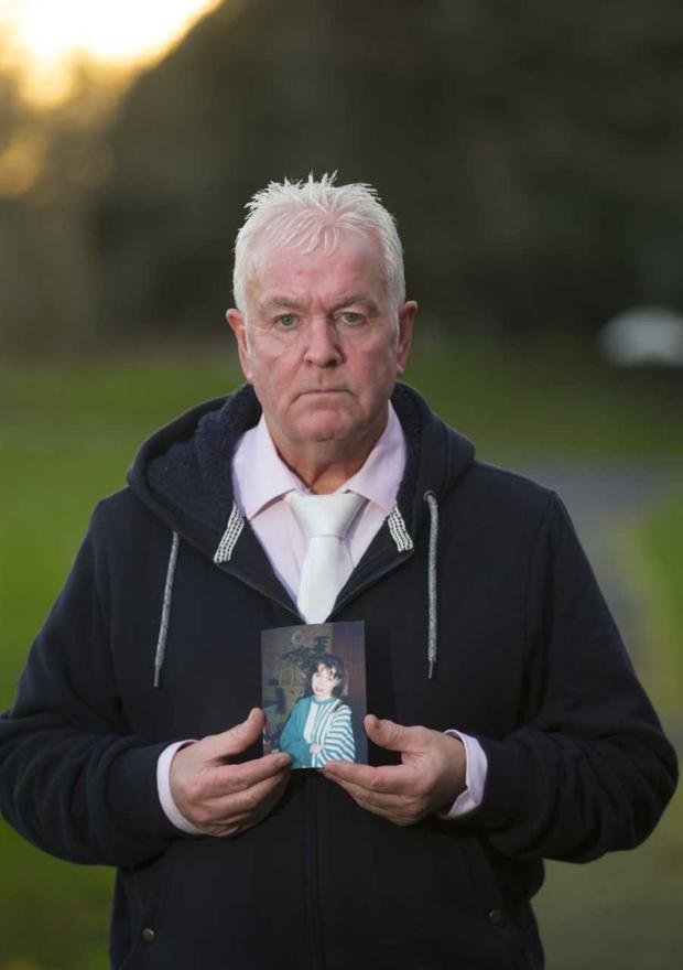 Keeping a brave face: Gerry Keenan with a picture of his sister, Imelda. Photo by Brownes Photography