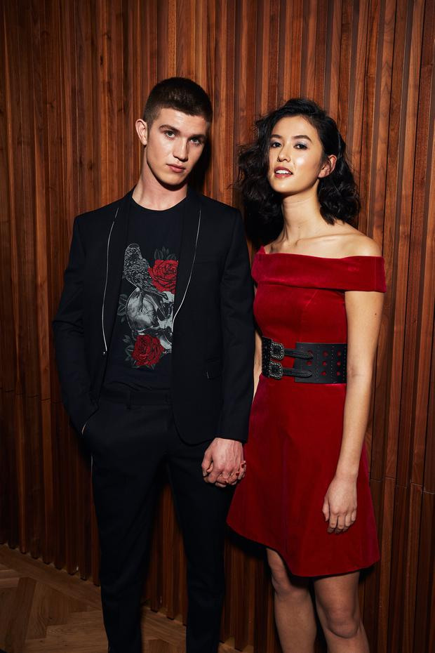 The Kooples man's jacket, €250, T-shirt, €55 and trousers, €120. Karen Millen red off-the-shoulder dress, €135; The Kooples belt, €110