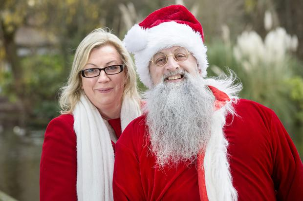 Gift appeal: Helen Walsh, who leads Operation Snowball, with Santa Claus (Jonathan Smith). Photo: Tony Gavin