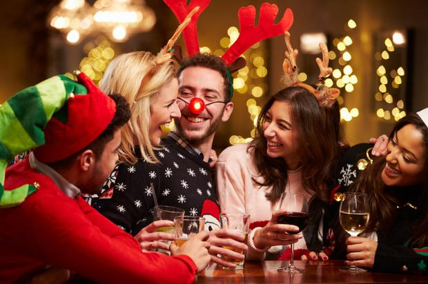 Grabbing a drink with friends on Christmas Eve. Stock photo