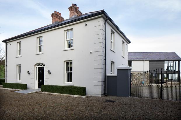 The original farmhouse has been restored in a way that is sympathetic to its era, with sash windows and cornicing on the ceilings