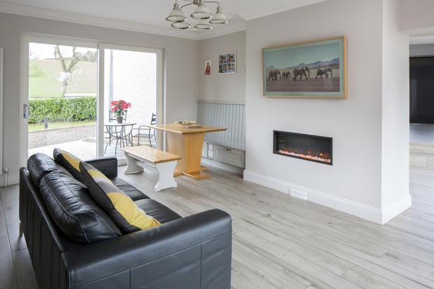 As well as the island, the family can eat at this table in the open-plan kitchen/living/dining room. This is just one of three sets of sliding glass doors in the open-plan room