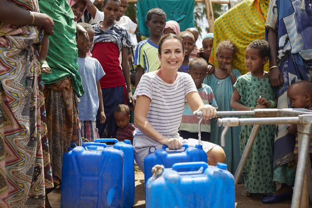 Lorraine at one of the tap stands provided by Oxfam. These stands distribute 50,000 litres of water every day to those in need