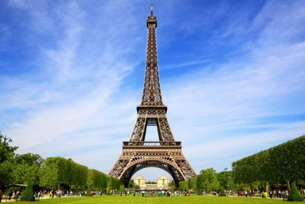 Eiffel Tower closed to visitors as intruder climbs up