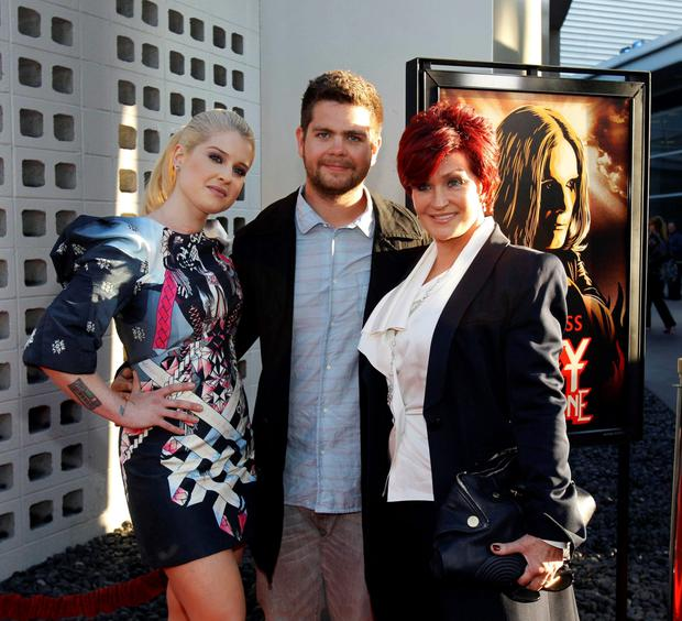 2011: Jack Osbourne poses with his mother Sharon Osbourne and his sister Kelly