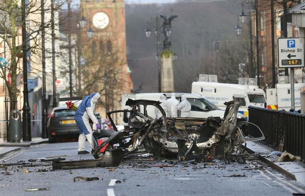 Shock waves: Forensic officers examine the remains of a car bomb that exploded outside the courthouse in Derry last Saturday. Photo: Margaret McLaughlin