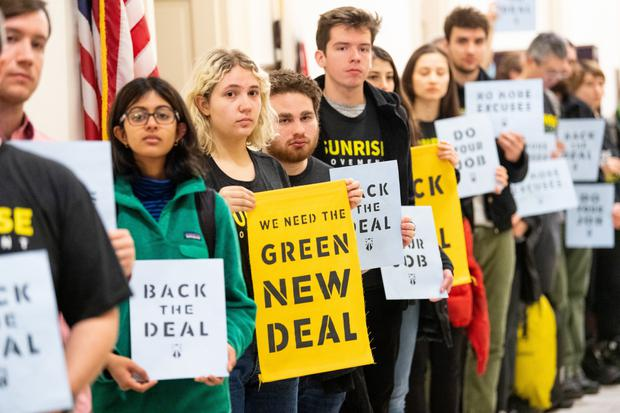 A new voice: Sunrise protesters inside the office of Nancy Pelosi call for Democrats to support the Green New Deal. Photo by Michael Brochstein