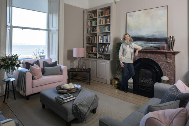 Designer Helen McAlinden in her front reception room with some of the furniture from the range. The mix of plain fabrics, plaids and checks make for an interesting combination. The sofa fabrics are all treated, and are of furnishing quality. Photo: Tony Gavin