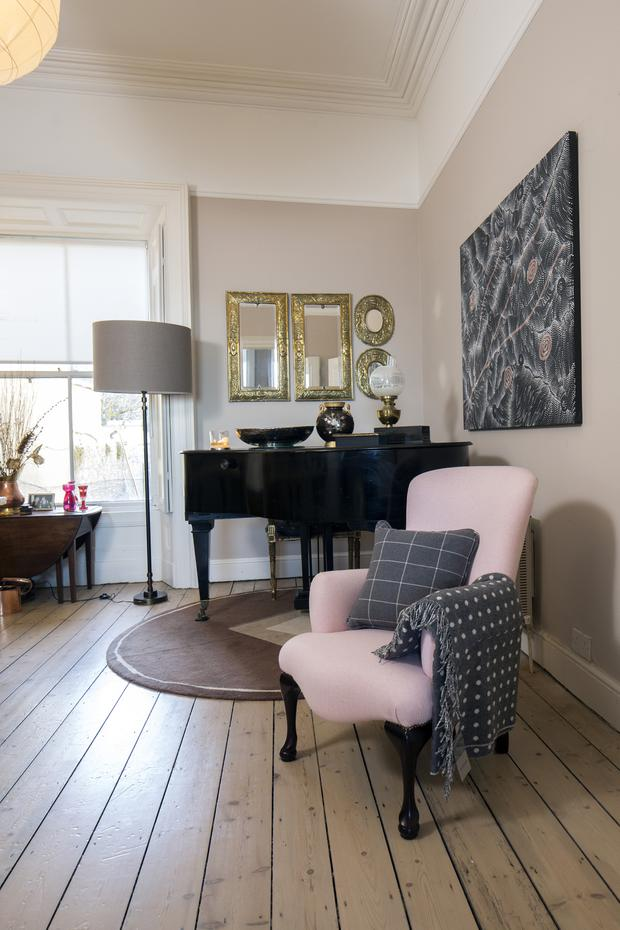 The grand piano in the back reception room came from Helen's father's family. She says she does sit and play occasionally, but badly. The floors thoughout were recently bleached and limed