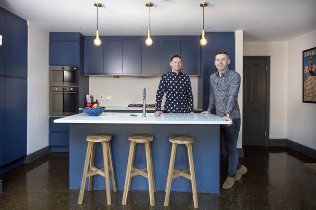 Eoin Callaghan, left, and Darran Heaney in their contemporary kitchen, complete with natural stone worktops. The floor is poured concrete. Photo: Tony Gavin