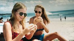 Emma (left) and Rachel enjoy street food in Lombok